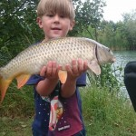 Young Wez bags carp on Victoria